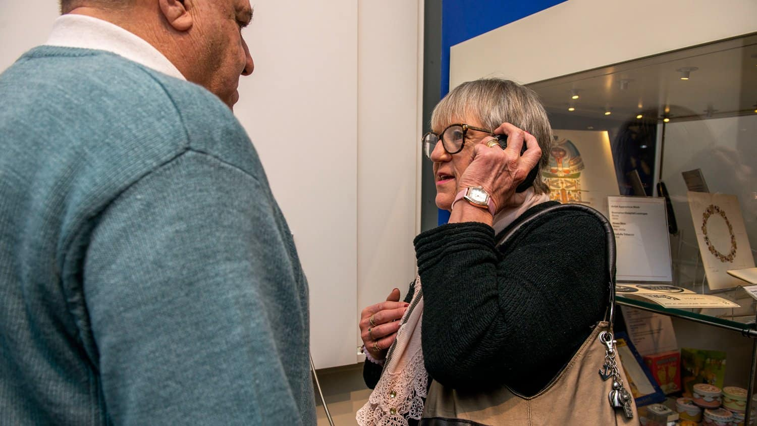 Visitor using Single Cup Headphones at the Barnsley Experience