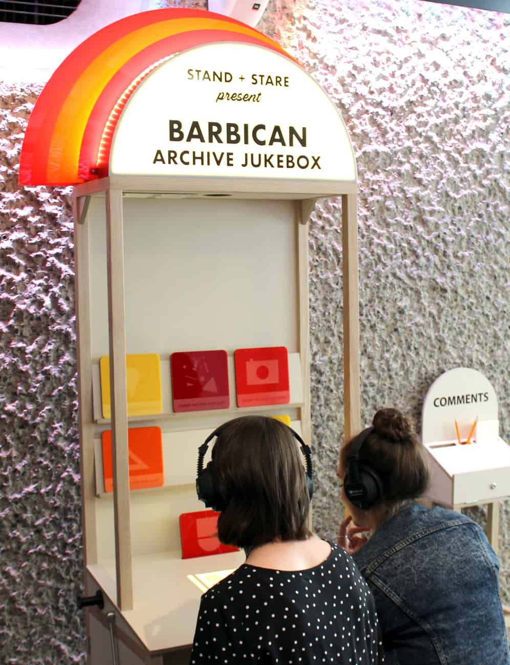 Two Visitors using MKII Headphones at Barbican Archive Jukebox
